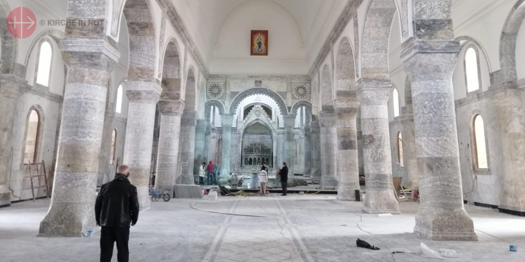 Iraq, diocese of Mossul-SIR, Qaraquosh in January 2021 The builders  doing their best ot complete the great Al-Tahira church for the planned Holy Father's visit in March 2021.IRAQ / MOSSUL-SIR 19/00080 Phase two of reconstruction of great Al-Tahira church, Qaraqosh (Baghdeda) (Syriac Catholic) - continuation (NRC) CP 030 IRAQ / MOSSUL-SIR 17/00070  ID: 1704874 Reconstruction of great Al-Tahera church, Quaraqosh
